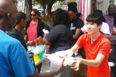 Students volunteering in the city to feed and clothe the hungry